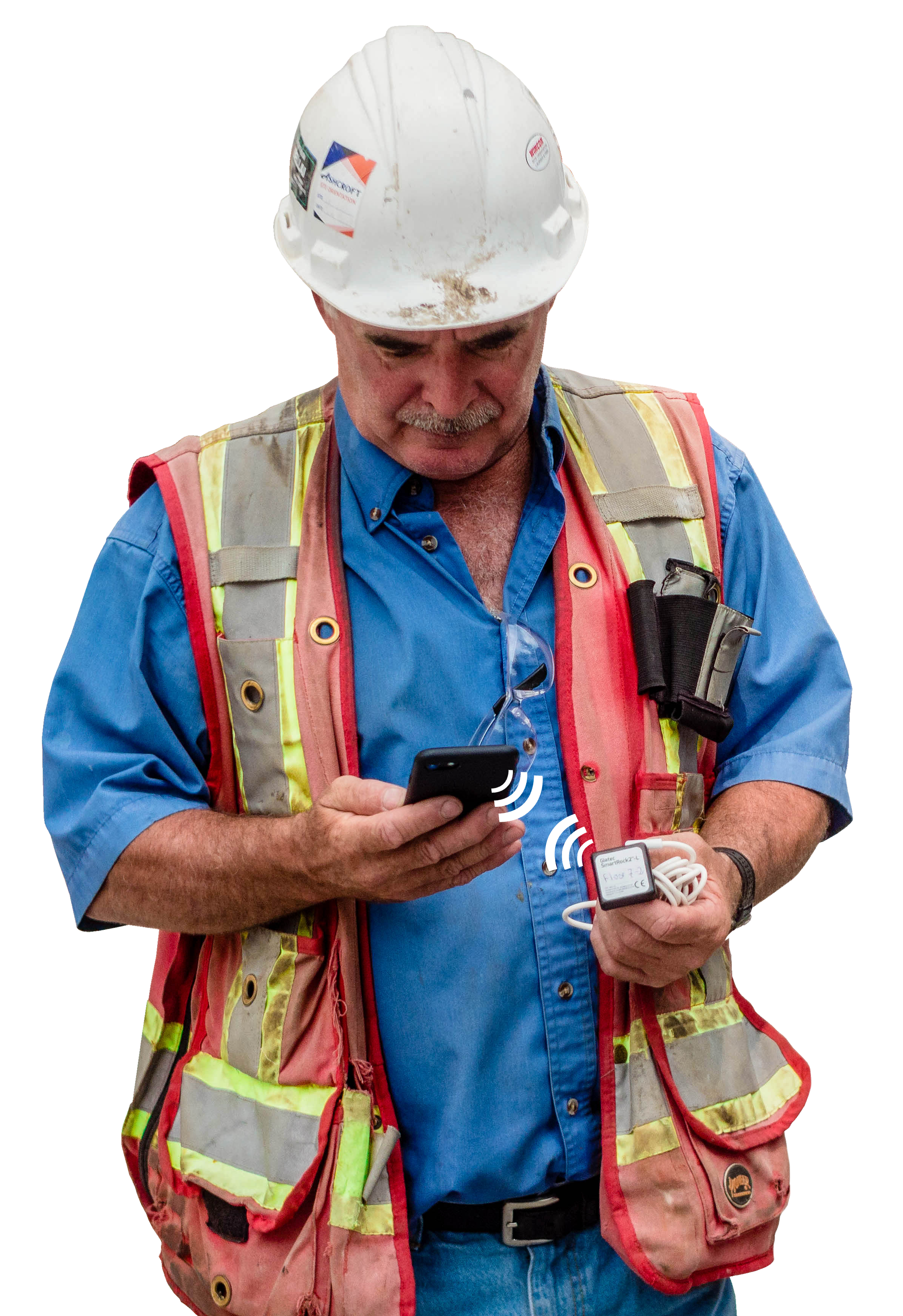 Construction worker holding a phone and smartrock sensor